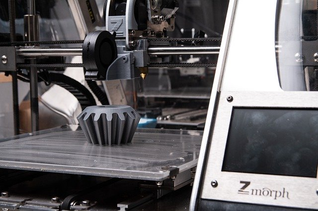 A 3D printing machine making a type of gear.