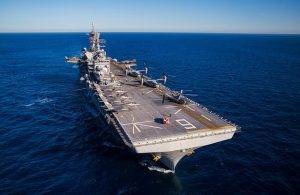 The USS America. An aircraft carrier can pivot and make 180 degree turns in minutes.