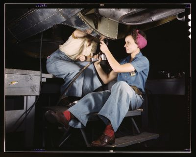 Women working on a bomber during WWII. We need more women in manufacturing.