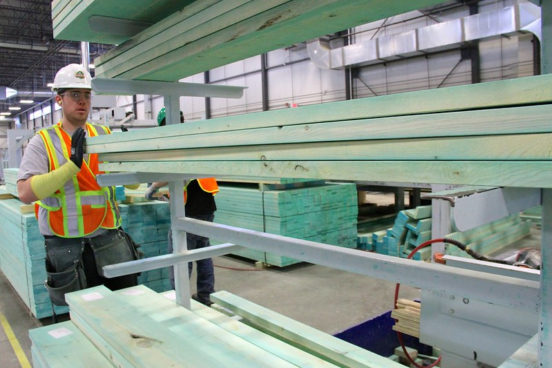 Photo of a green manufacturing worker in the Landmark Homes manufacturing plant in Edmonton Alberta.