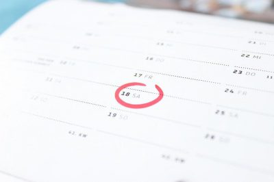 A calendar with a date circled on it. The annual performance review is a terrible waste of time and is totally useless.